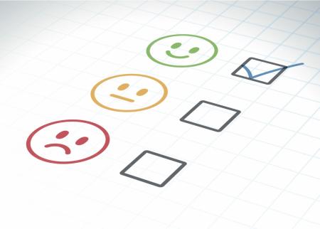 A check box next to a smiley face
