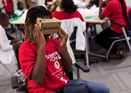 A Science in the City student using a cardboard virtual reality viewer