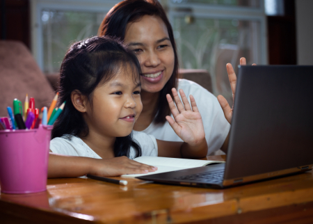 Mother and child doing school on a laptop