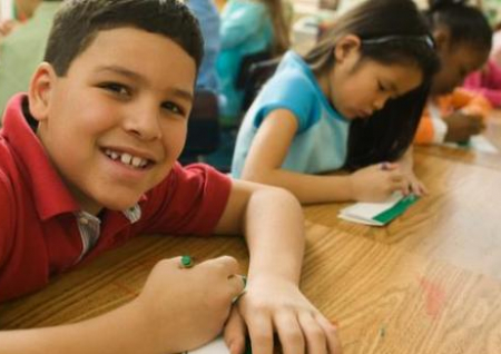 children learning in a classroom setting