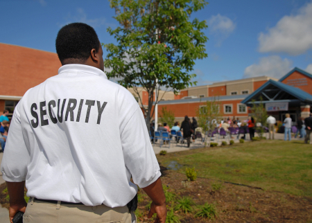 a security guard outside of a school