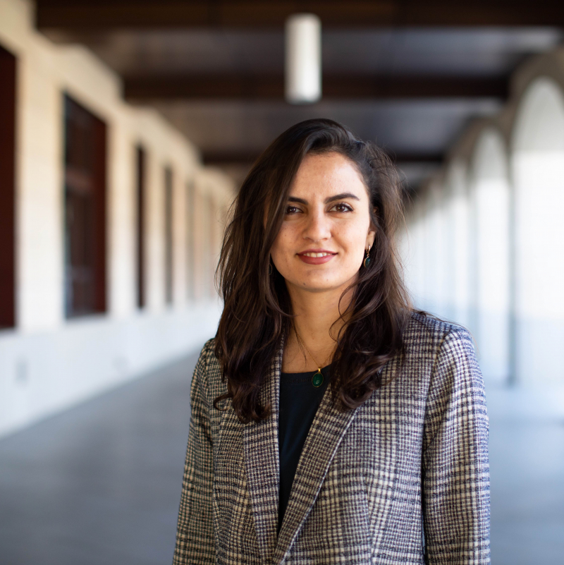 Faculty member Shima Salehi, photographed standing in a Stanford arcade