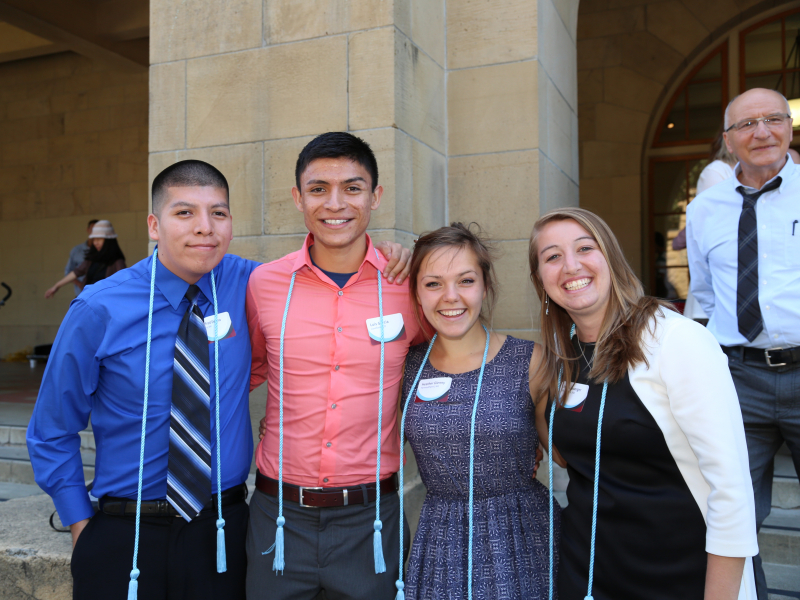 Photo of four students during GSE honor's cord ceremony