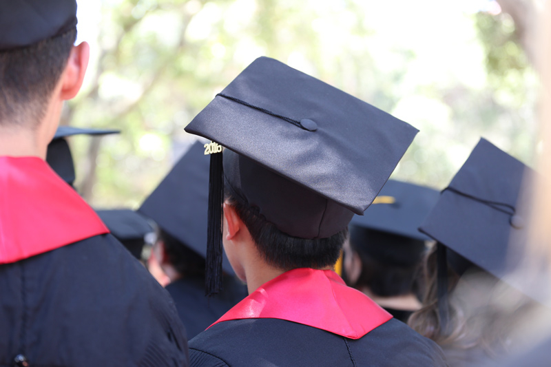 Photo of a students backs during graduation ceremony
