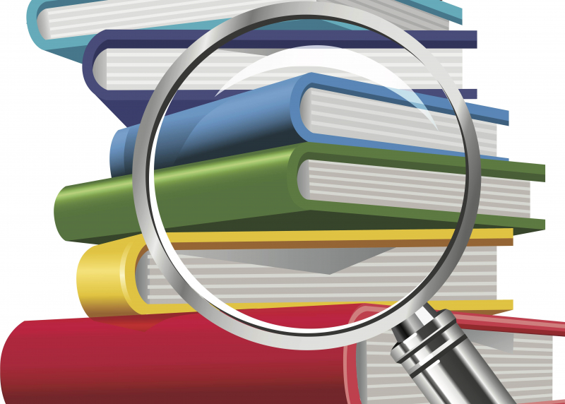 Magnifying glass on a stack of textbooks