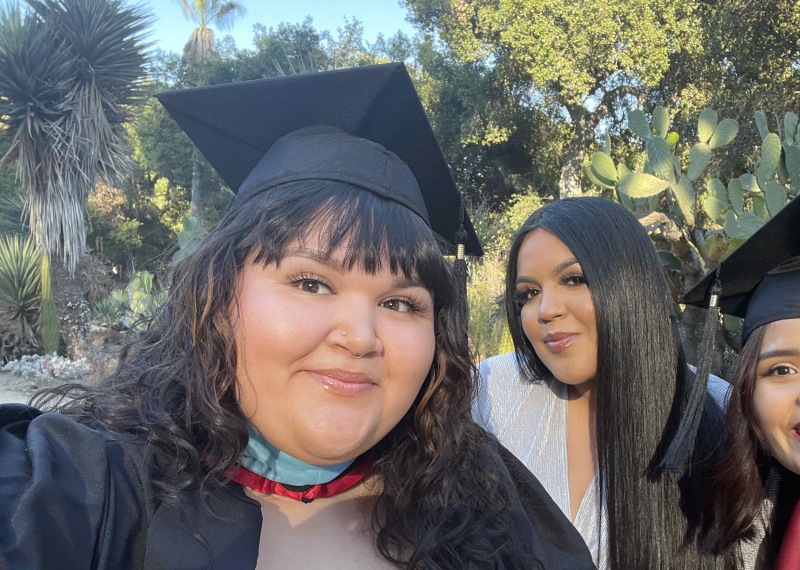 Photo of three STEP students in graduation caps and gowns