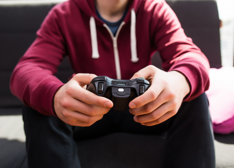 Man playing video games. Photo by Adobe Stock