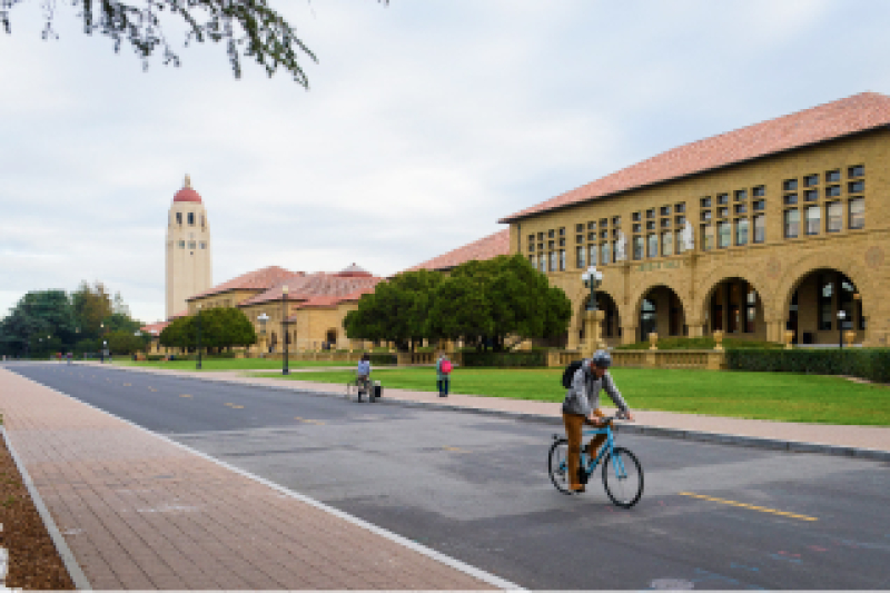 Student riding bicycle on Stanford campus
