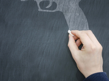 Illustration of a gun being drawn on a chalkboard