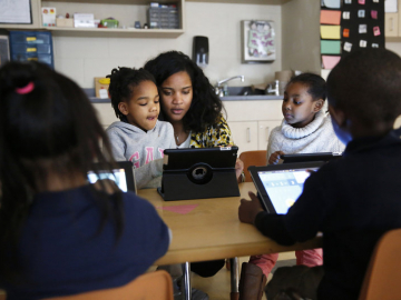 Kindergarten teacher Marissa McGee with several students. (Photo by Elissa Nadworny/NPR)