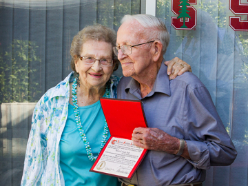 Margaret and Bonnie Gould show the Stanford diploma he received in 1954. This year he was able to participate in the ceremony he skipped 61 years ago. (Photo by Norbert von der Groeben)