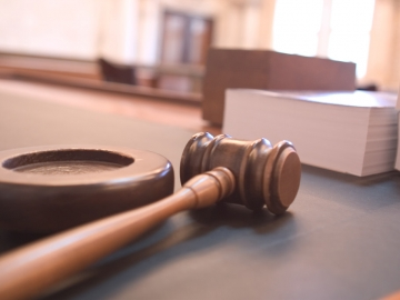 Photo of gavel in a courtroom