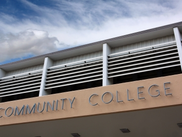"""a building with a sign reading """"community college"""""""