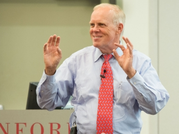 Stanford President John Hennessy speaks to participants in the Hollyhock Fellowship for Teachers program during their lunchtime session Tuesday. (Photo by LA Cicero)