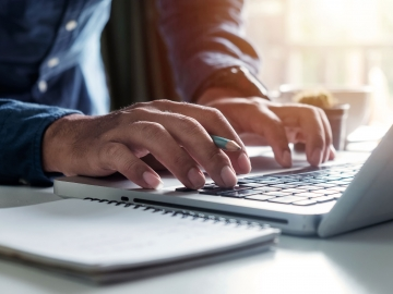 Photo of man typing on keyboard. (Photo: mrmohock/Shutterstock)