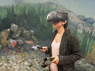 Wearing a virtual reality headset, a researcher tries out the Stanford Ocean Acidification Experience, a new VR science educatio