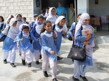 Study finds that a brief phone call improves student enrollment in Pakistan. (Vicki Francis/Dept for International Development)
