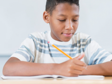 Photo of African American boy doing a writing exercise