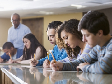 A Stanford professor's report on voucher programs shows they do not improve student outcomes. (kali/Getty)