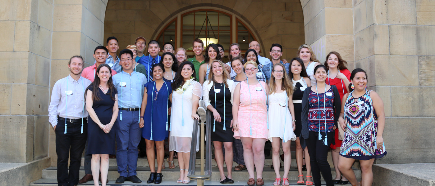Photo of undergraduate students with John Willinsky and other faculty members
